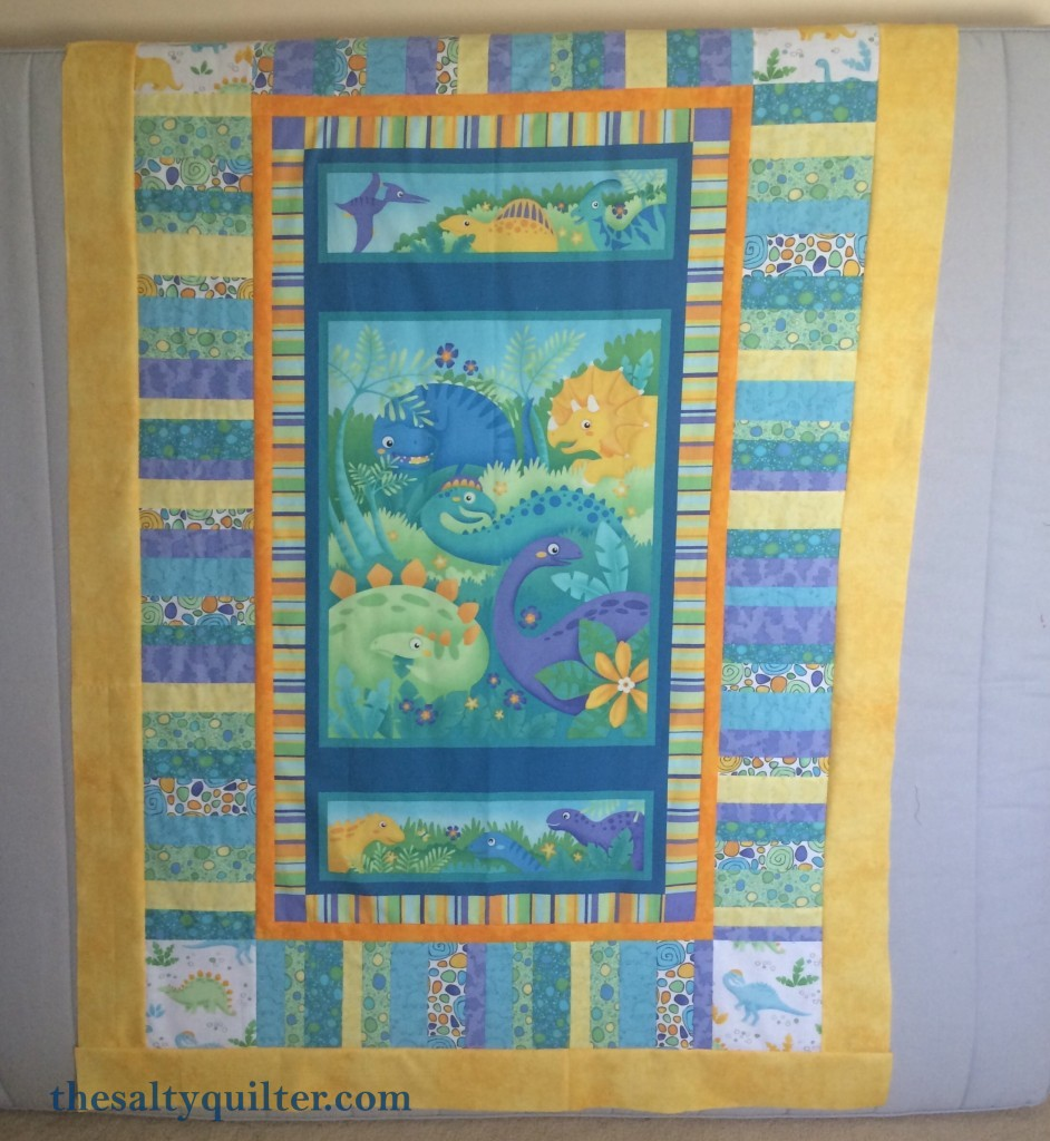 The Salty Quilter - In Defence of Panels - Dino panel quilt top